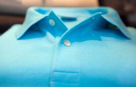 Photo of cyan Shirt poloin a clothes shop photo