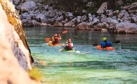 Kayaking in the summer on the Soca river, Slovenia Imagens