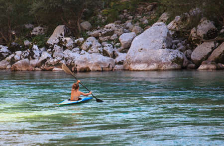 Kayaking in the summer on the Soca river, Slovenia photo