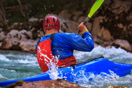 waterspout: Kayaking in the summer on the Soca river, Slovenia Stock Photo