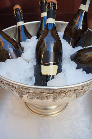 Buffet, Wine bottles in silver cold ice bucket photo