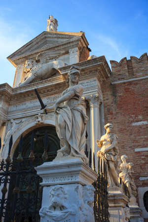 Statues, entrance of the Arsenale in Venice, Italy  photo