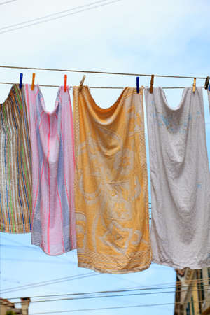 Clothes hanging to dry on a clothes-line photo