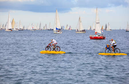 TRIESTE, ITALY - 14 OCTOBER 2012: Waterbikes near the boats in the minutes before the start of Barcolana regatta in Trieste sea,  northern part of the Adriatic Sea. About 2000 boats and thousands of sailors from all over the world took part in the race.  Stock Photo - 15792745