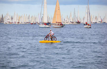 TRIESTE, ITALY - 14 OCTOBER 2012: Waterbikes near the boats in the minutes before the start of Barcolana regatta in Trieste sea,  northern part of the Adriatic Sea. About 2000 boats and thousands of sailors from all over the world took part in the race.