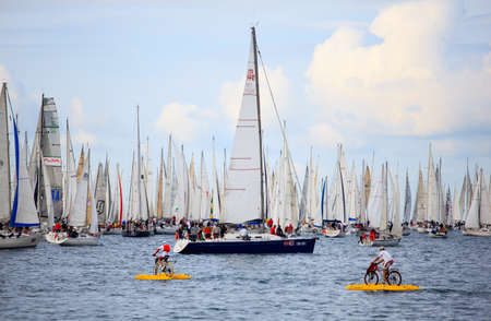 TRIESTE, ITALY - 14 OCTOBER 2012: Waterbikes near the boats in the minutes before the start of Barcolana regatta in Trieste sea,  northern part of the Adriatic Sea. About 2000 boats and thousands of sailors from all over the world took part in the race.  Stock Photo - 15792720