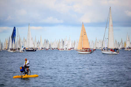 TRIESTE, ITALY - 14 OCTOBER 2012: Waterbikes near the boats in the minutes before the start of Barcolana regatta in Trieste sea,  northern part of the Adriatic Sea. About 2000 boats and thousands of sailors from all over the world took part in the race.  Stock Photo - 15792743