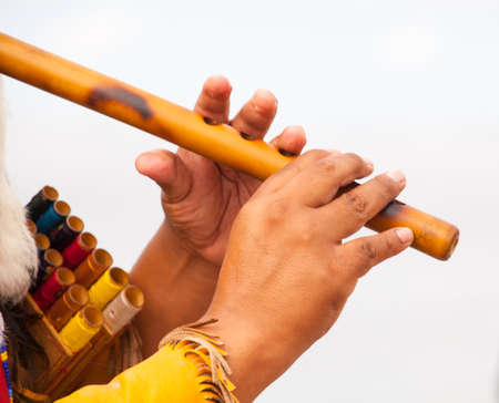 Peruvian Man In Native Costume Playing flute Imagens