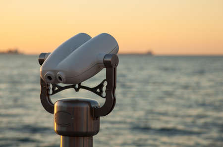 Photo of a tourist binoculars next to the sea in Trieste