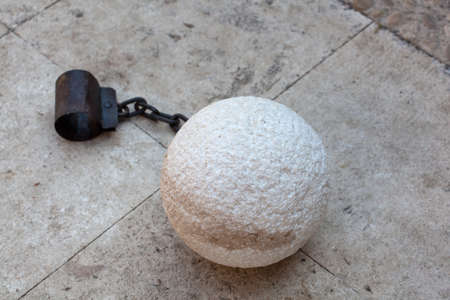 restraint device:  prisoner ball and chain