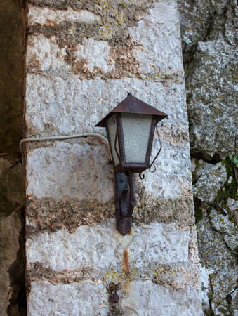 an old style lantern on a wall Stock Photo - 17216551