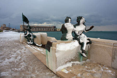 Statue covered by snow in Trieste, Italy photo