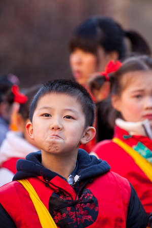 MILAN, ITALY - FEBRUARY 10: Child in traditional costume in the Chinese New Year parade in Milan on February 10, 2013