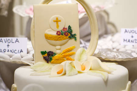 the first communion: Cake and decorations for the celebration of First Communion