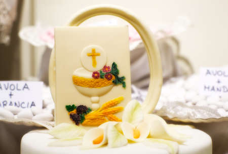 Cake and decorations for the celebration of First Communion photo