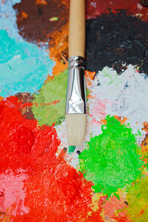 Paintbrush on colorful palette photo
