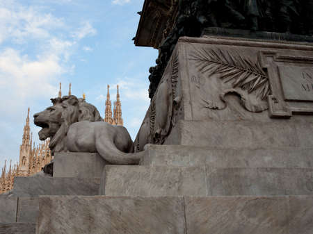 Lion statue of Vittorio Emanuele II monument in Piazza del Duomo Milan, Italy  photo