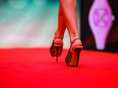 Model walking on runway during fashion show