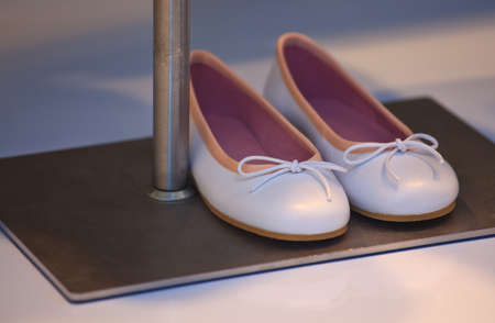 View of white and pink female shoes Stock Photo