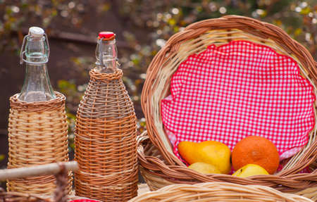 pic nic: Close up of Bottles and wicker baskets