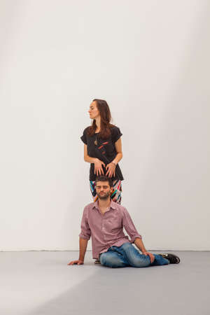 """immaterial: VENICE, ITALY - MAY 29: Performance in the Romanian Pavilion in the Venice biennale. Alexandra Pirici and Manuel Pelmuş. An Immaterial Retrospective of the Venice Biennale, 2013. Quotation of """"Wall Enclosing a Space"""", intervention by Santiago Sierra, Editorial"""