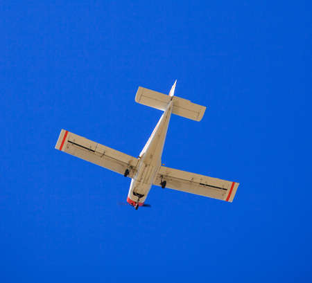 aerobatics: View of airplane in the blue sky