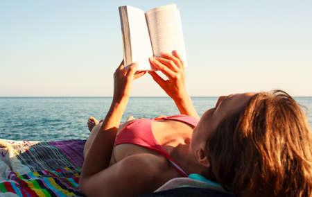 bathers: Girl Reading book in the beach, Pantelleria Stock Photo