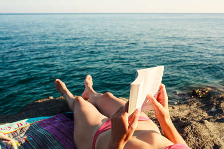 Girl Reading book in the beach, Pantelleria Stock Photo - 22485784