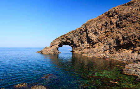 View of Arco dell'Elefante in the Pantelleria island, Sicily Imagens