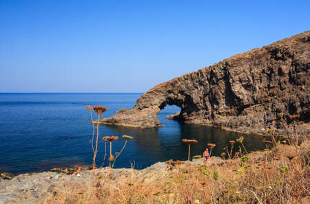 View of Arco dellElefante in the Pantelleria island, Sicily Imagens