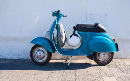 Vespa, famous italian motorcycleparked in the street