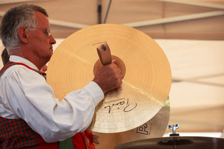 cymbals: BOLZANO, ITALY - SEPTEMBER 15: Musician with cymbals during the concert on September 20, 2013