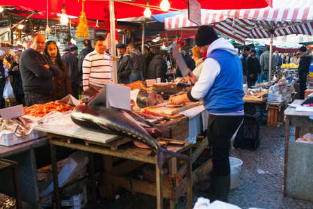 PALERMO, ITALY - DECEMBER 28, 2013: View of open air seafood market in Ballaro famous neighborhood in Palermo Editorial