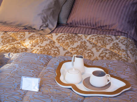View of Flatware and tray on the bed photo