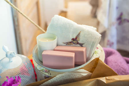 Close up of rose soaps and towel photo