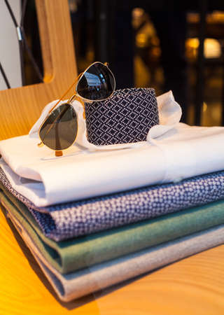 View of mens shirts, necktie and shades