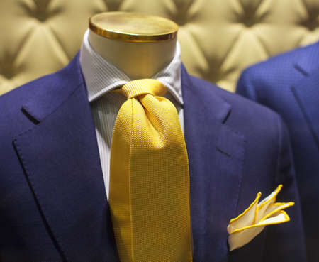 Business suits on shop mannequins high fashion retail display photo