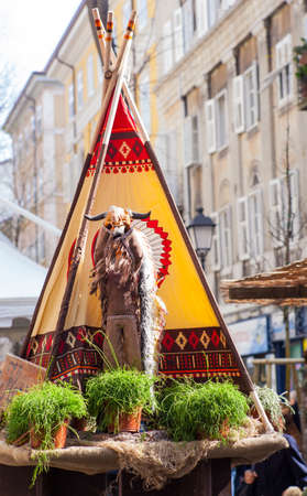 tepee: View of native American statue next to the tepee Editorial