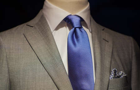 Close up of male suit exposed in the clothes shop photo
