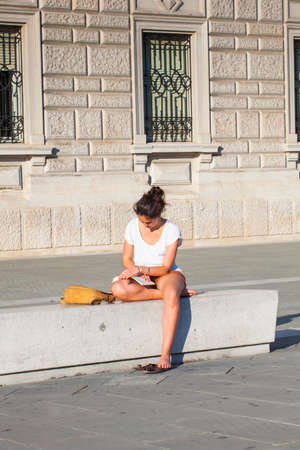 trieste: TRIESTE, ITALY - JUNE, 13: Young girl studying for College test on June 13, 2013 Editorial