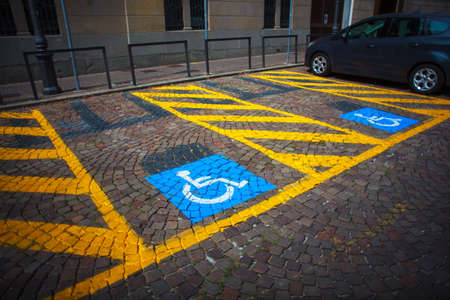 Parking for cars and signal for the disabled photo