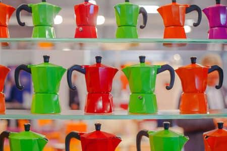 with coffee maker: View of many colorful Mocha, Italian coffee maker Stock Photo