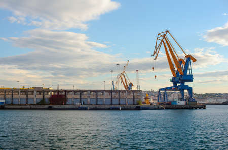 Crane working with container cargo shipyard in Trieste