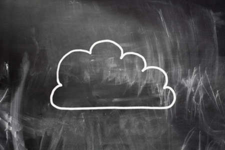 Cloud computing concept. Cloud draw with white chalk on blackboard photo