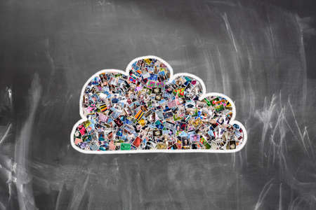 Cloud computing concept. Many photos inside a cloud on blackboard photo