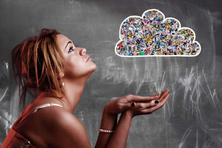 Cloud computing concept. Girl looking at cloud composed with many photos photo