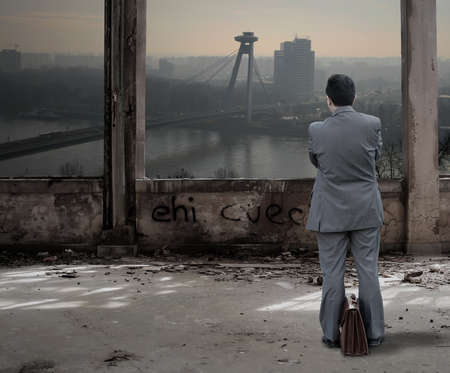 Business man in the abandoned building photo