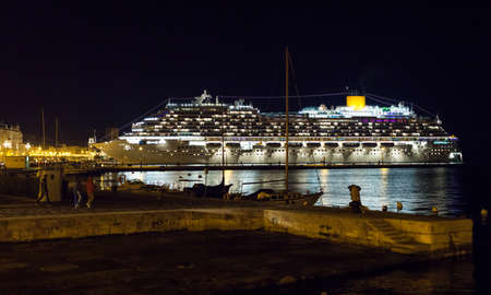 Night view of cruise ship illuminated docked in the Trieste pier