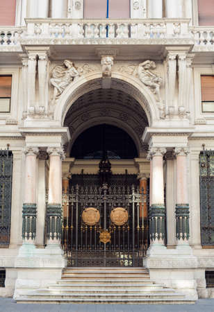 eclecticism: TRIESTE, ITALY - OCTOBER, 26: Entrance of RAS building in Trieste on October 26, 2014