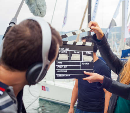 TRIESTE, ITALY - OCTOBER 12: Girl holding clapperboard During the production of short films on October 12, 2014